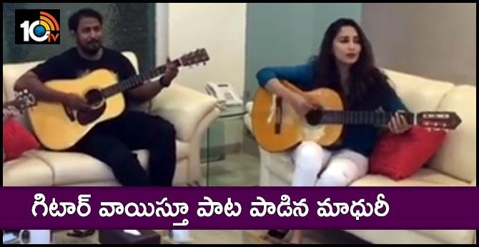 Madhuri Dixit plays guitar