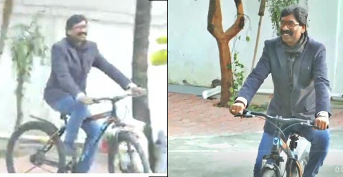 Jharkhand Mukti Morcha's (JMM) Hemant Soren rides a cycle at his residence in Ranchi