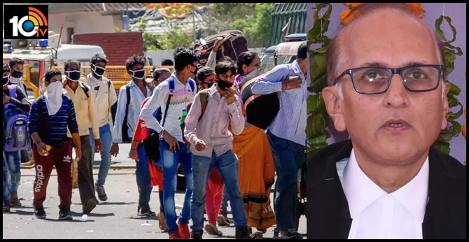 No security cover, SC's Justice S Ravindra Bhatt hands over food to migrants on roads