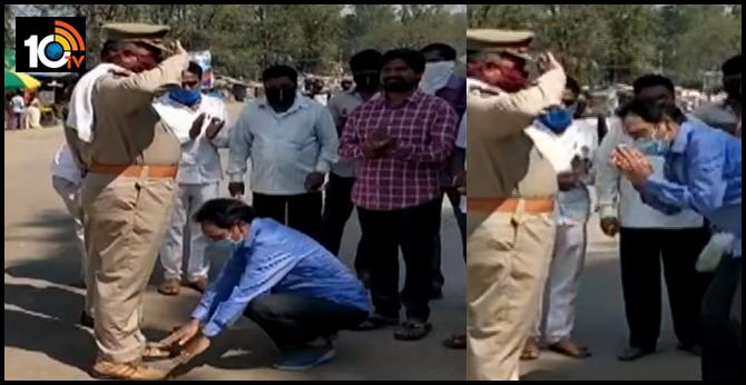 ysrcp mla touches police feet