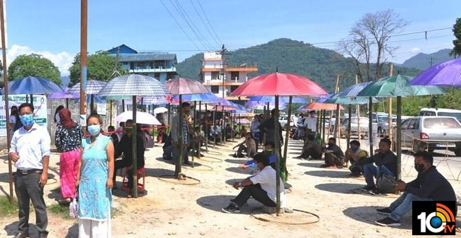 Shed of umbrellas outside West Siang
