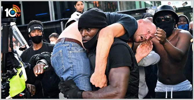 Photo Of Black Man Carrying Injured White Man At London Protests Is Viral