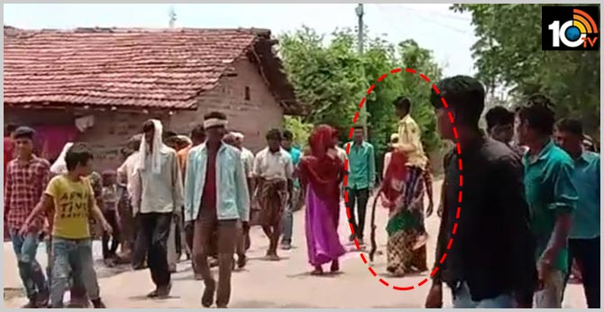 Woman forced to carry husband on shoulders and paraded as 'punishment' for eloping