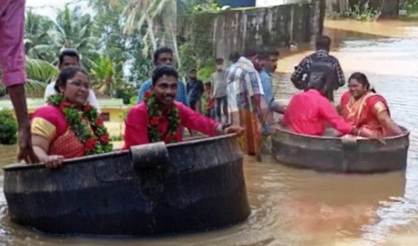 Kerala Floods: వంటగిన్నెలో వెడ్డింగ్ హాల్కు చేరుకున్న వధూవరులు